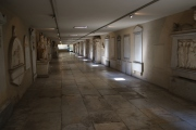 A hallway full of tombs