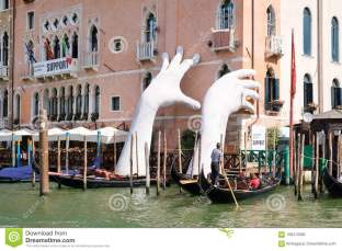 The hands (image: https://www.dreamstime.com/giant-hands-supporting-old-palace-next-to-grand-canal-venice-italy-july-work-art-lorenzo-quinn-image108413082 )